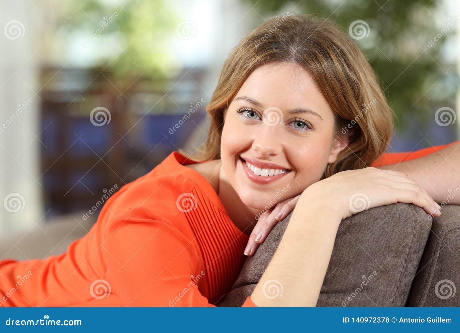 Happy woman posing at home looking at camera