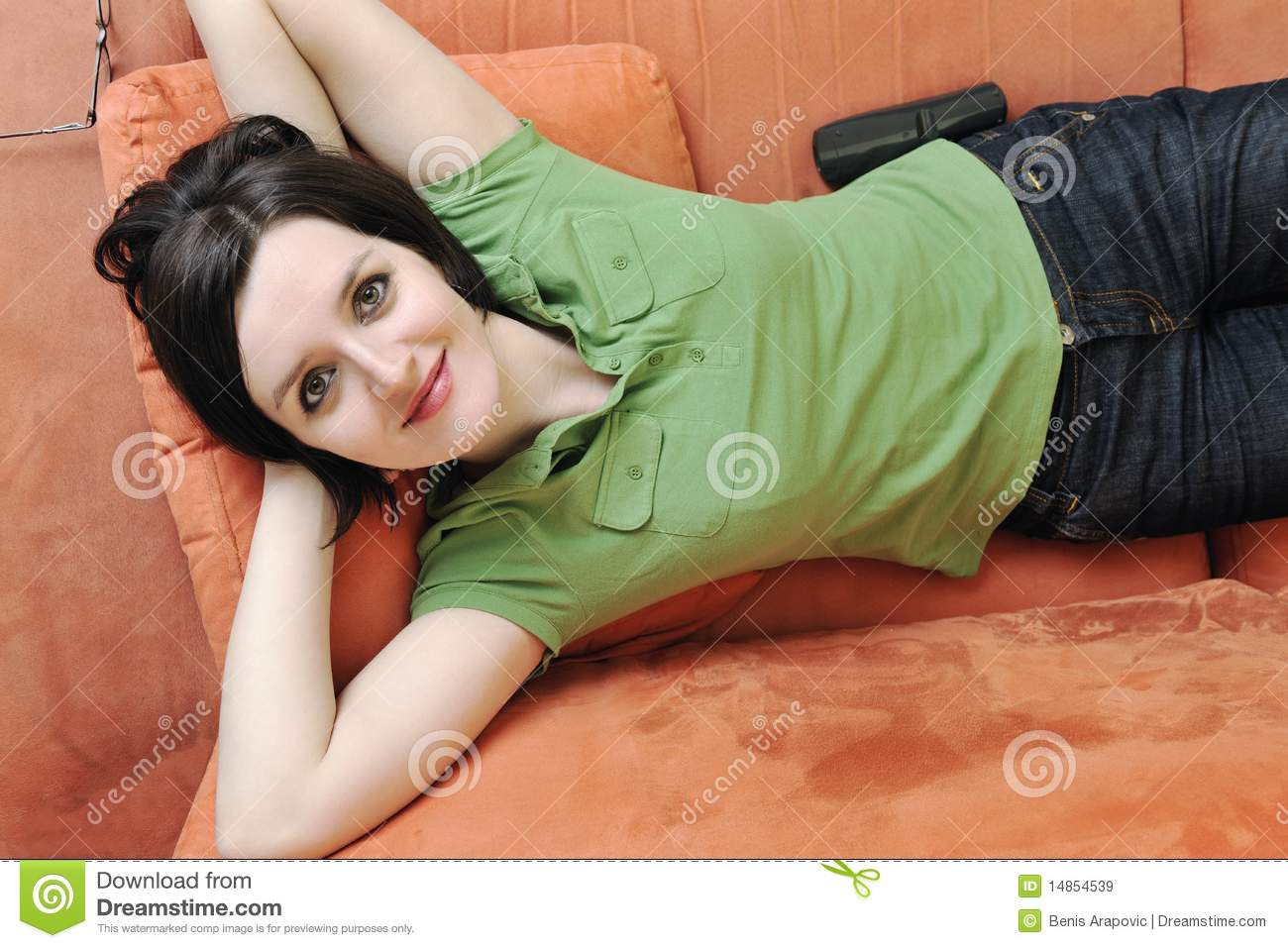 Happy woman relax on orange sofa