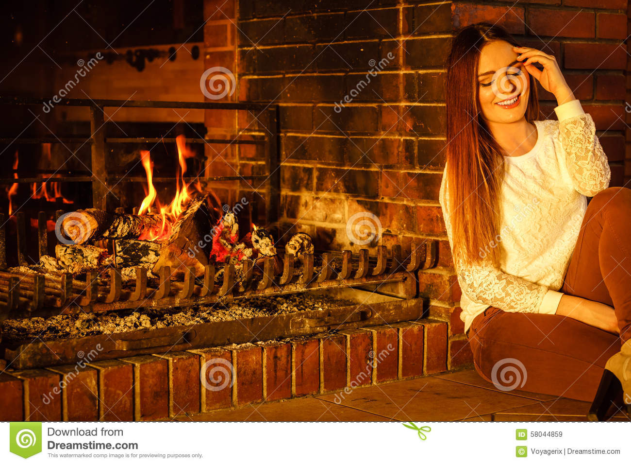 Happy Woman Relaxing At Fireplace  Winter Home  Stock Image