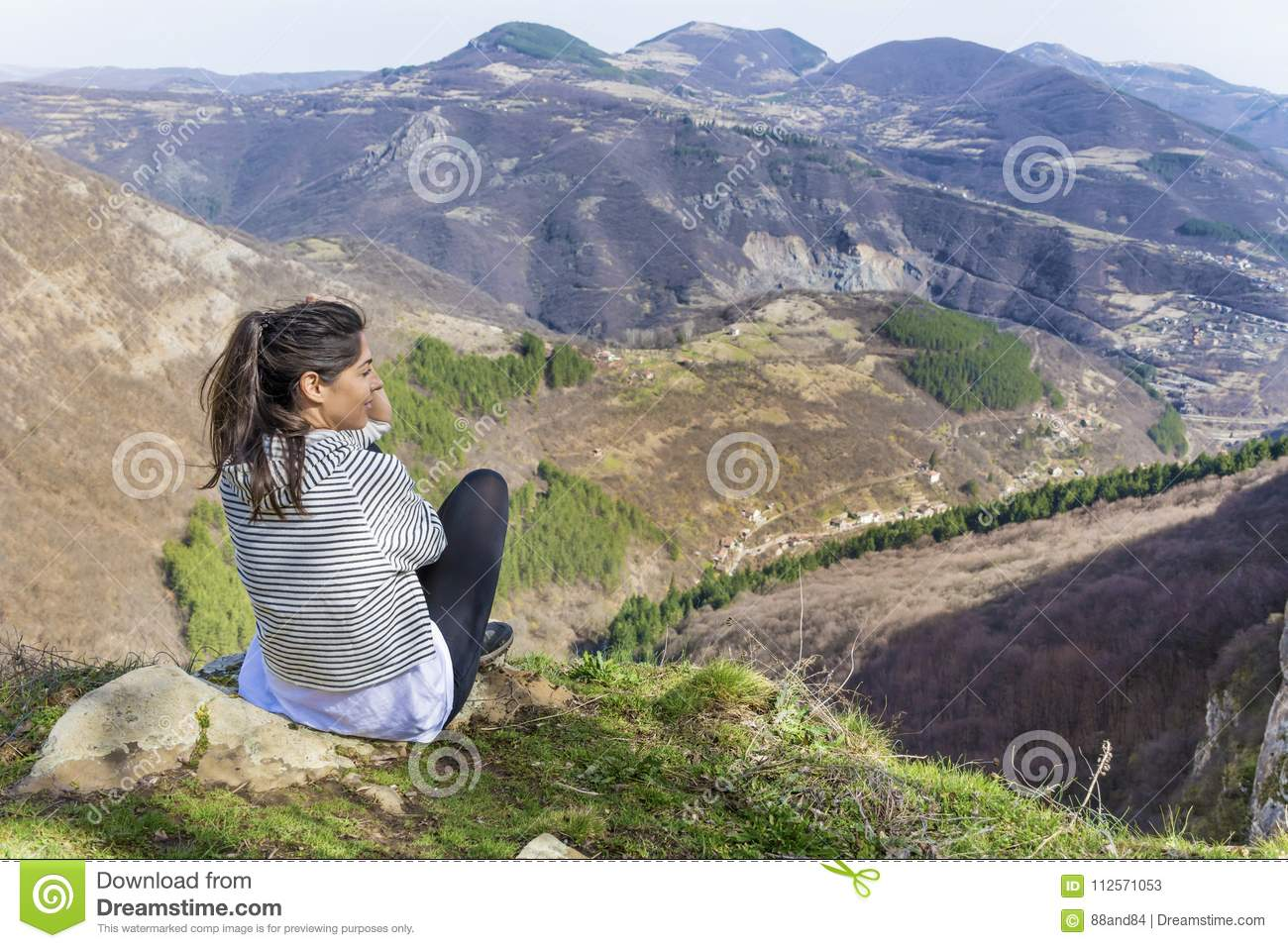 Happy Woman in a High Mountain