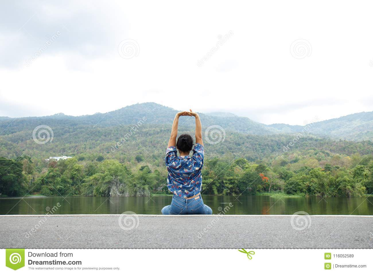 Happy woman relaxing in park and breathing fresh air outdoors. E