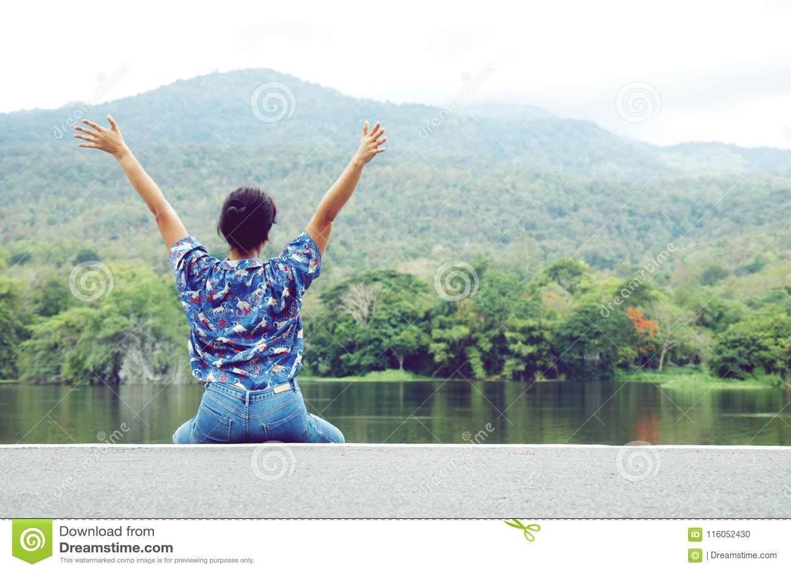 Happy woman relaxing in park.