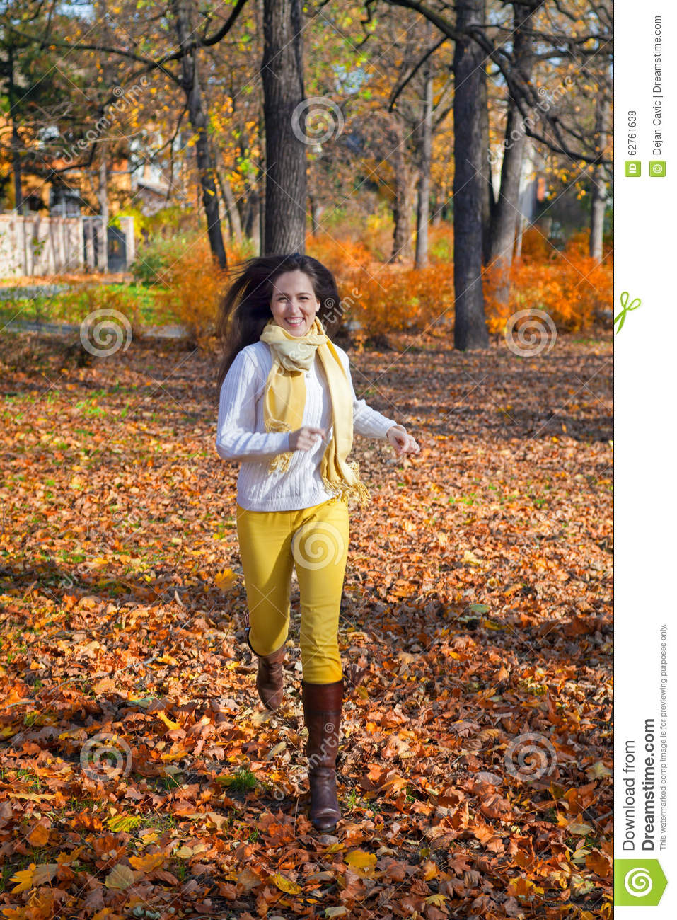 Happy woman running in autumn park stock photo image for Cheerful nature