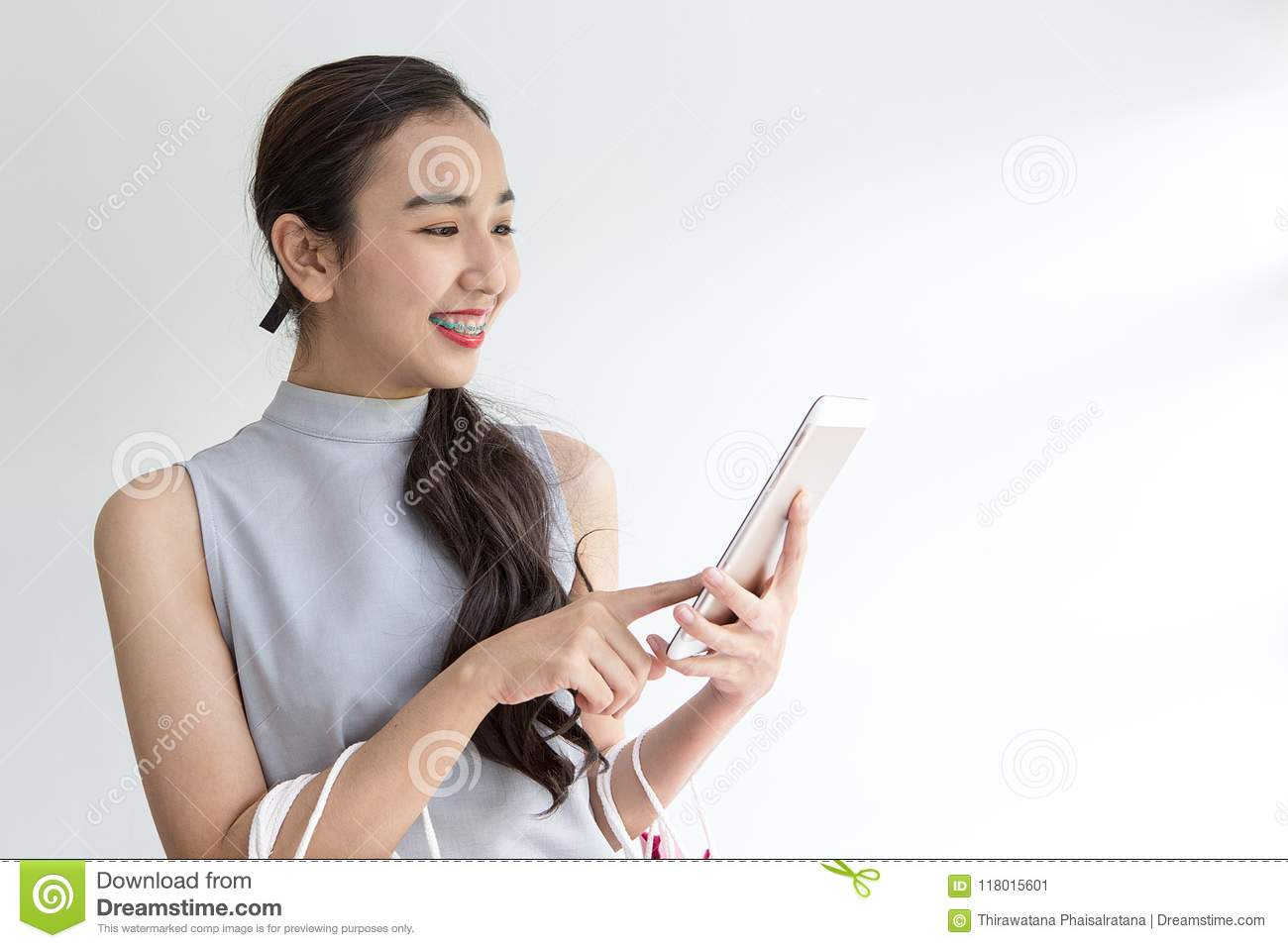 Happy Woman With Shopping Bag And Mobile Phone  Makes Online