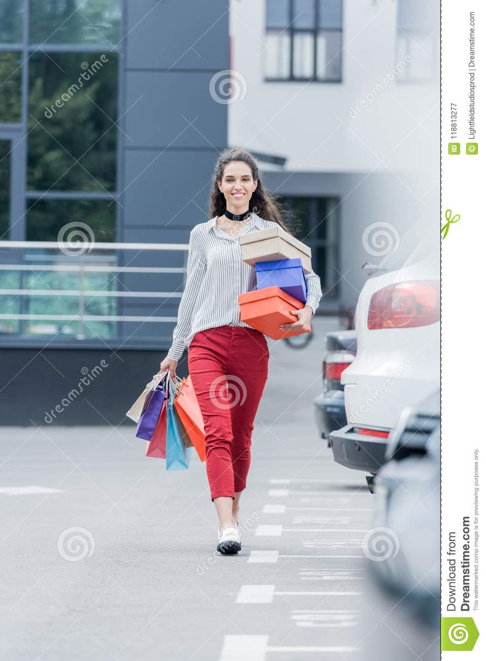 happy woman with shopping bags and boxes