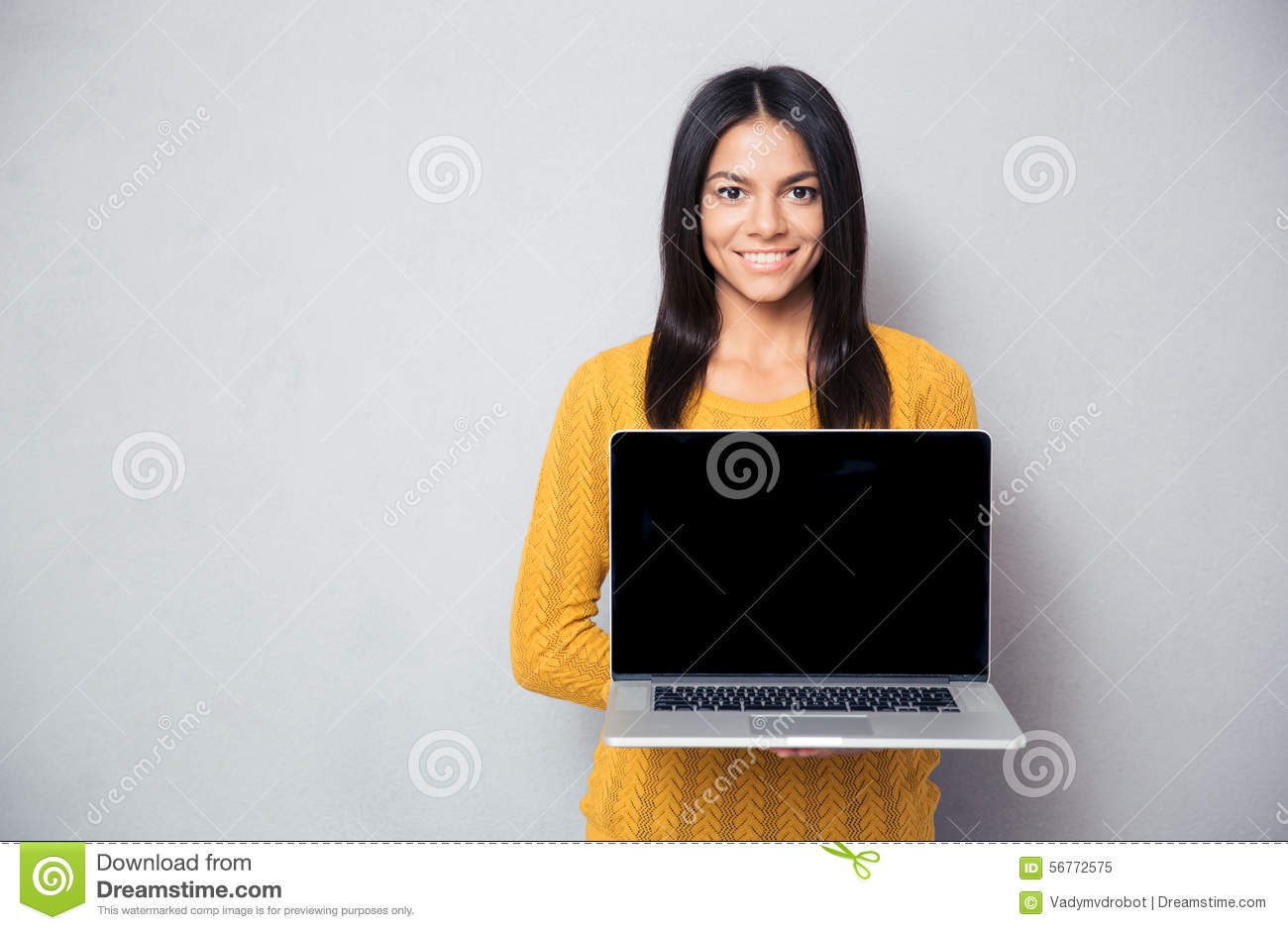 Happy woman showing blank laptop screen