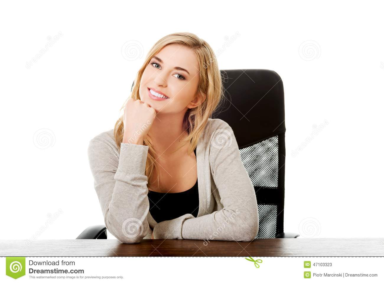 happy-woman-sitting-desk-touching-chin-47103323.jpg