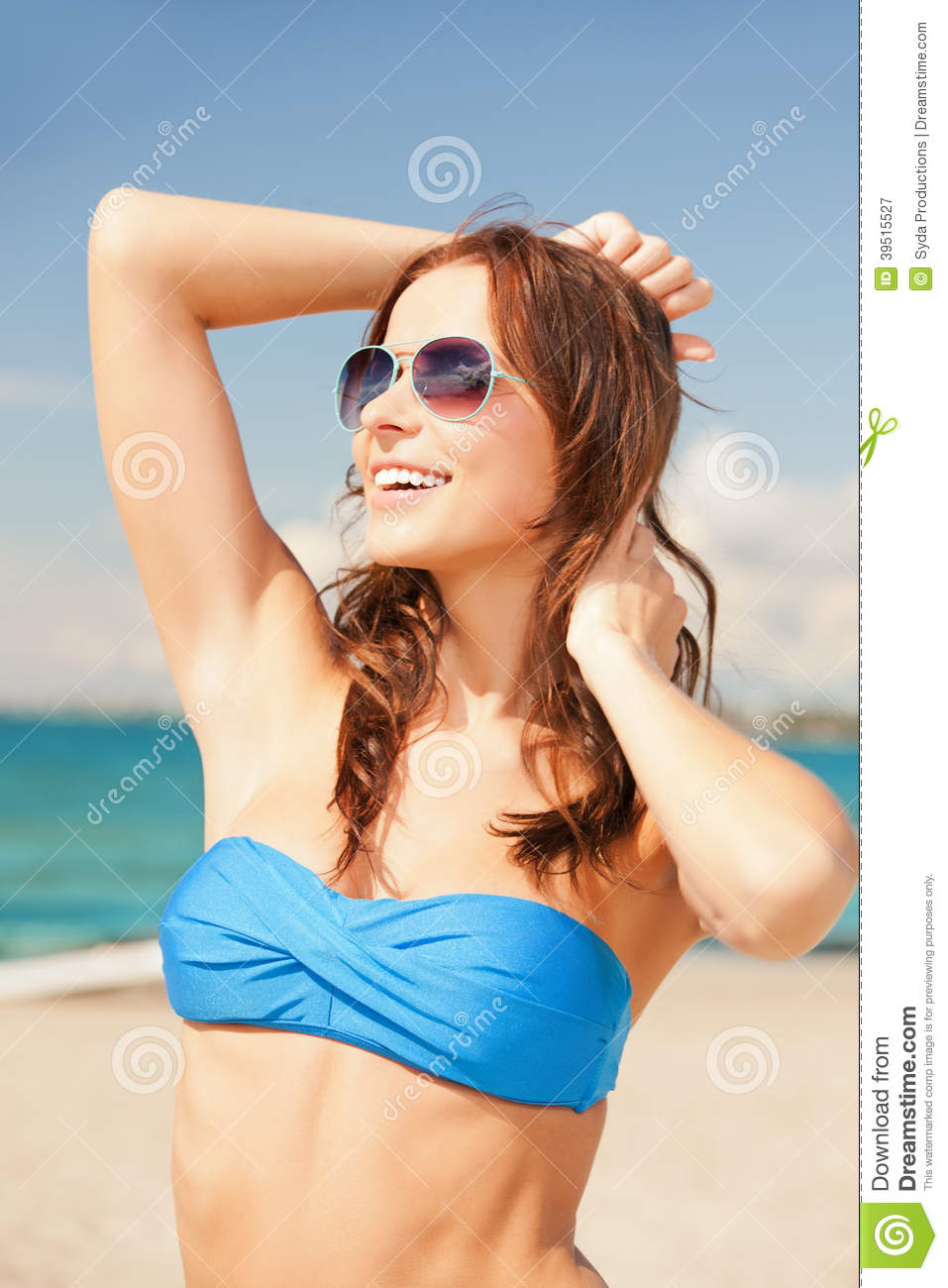 Happy woman in sunglasses on the beach