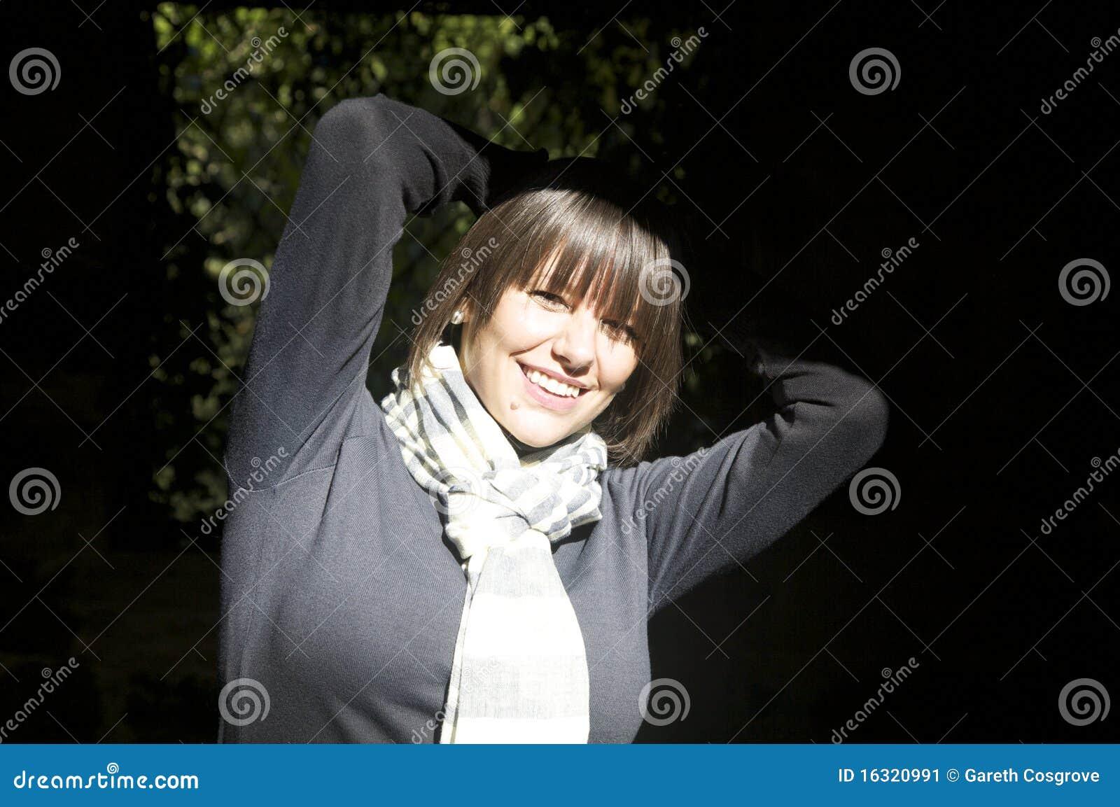 Happy woman in sunlight