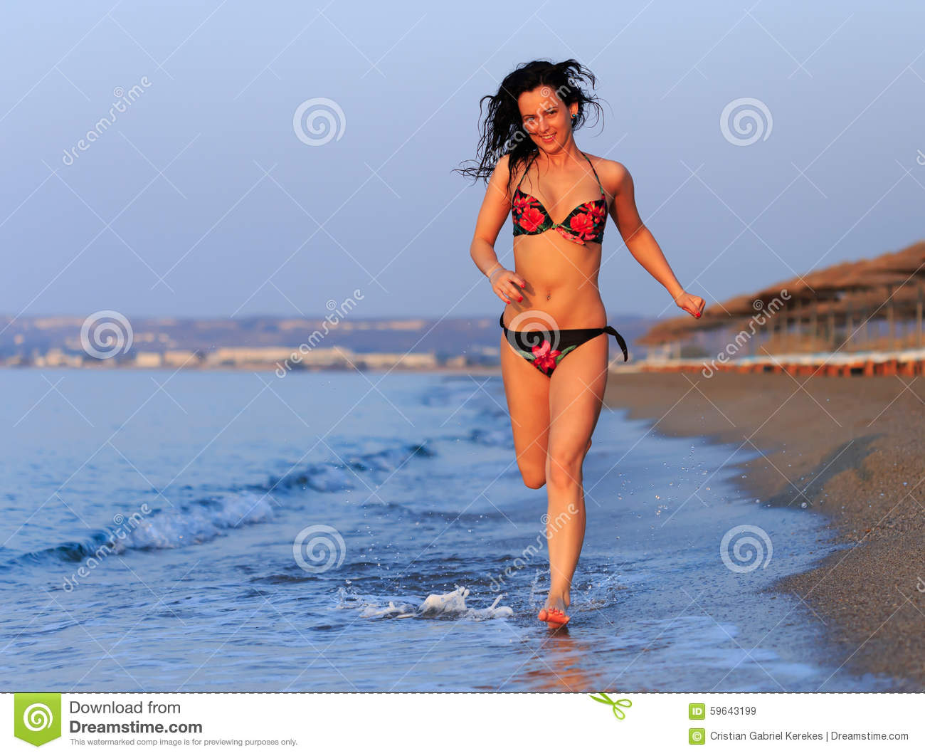 happy-woman-swimsuit-running-beach-sunrise-59643199.jpg