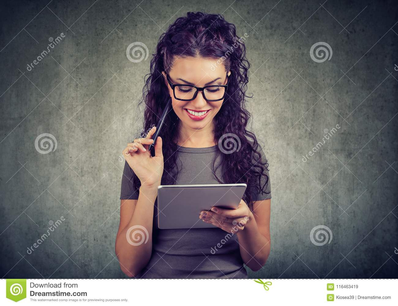 Happy woman with tablet computer and pen has an idea