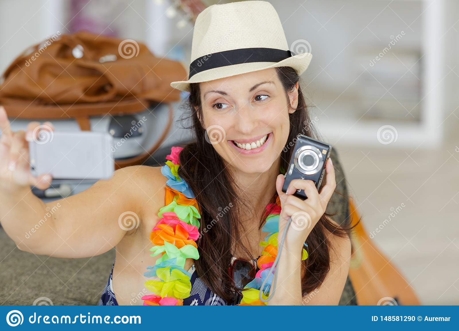 Happy woman taking selfie at home