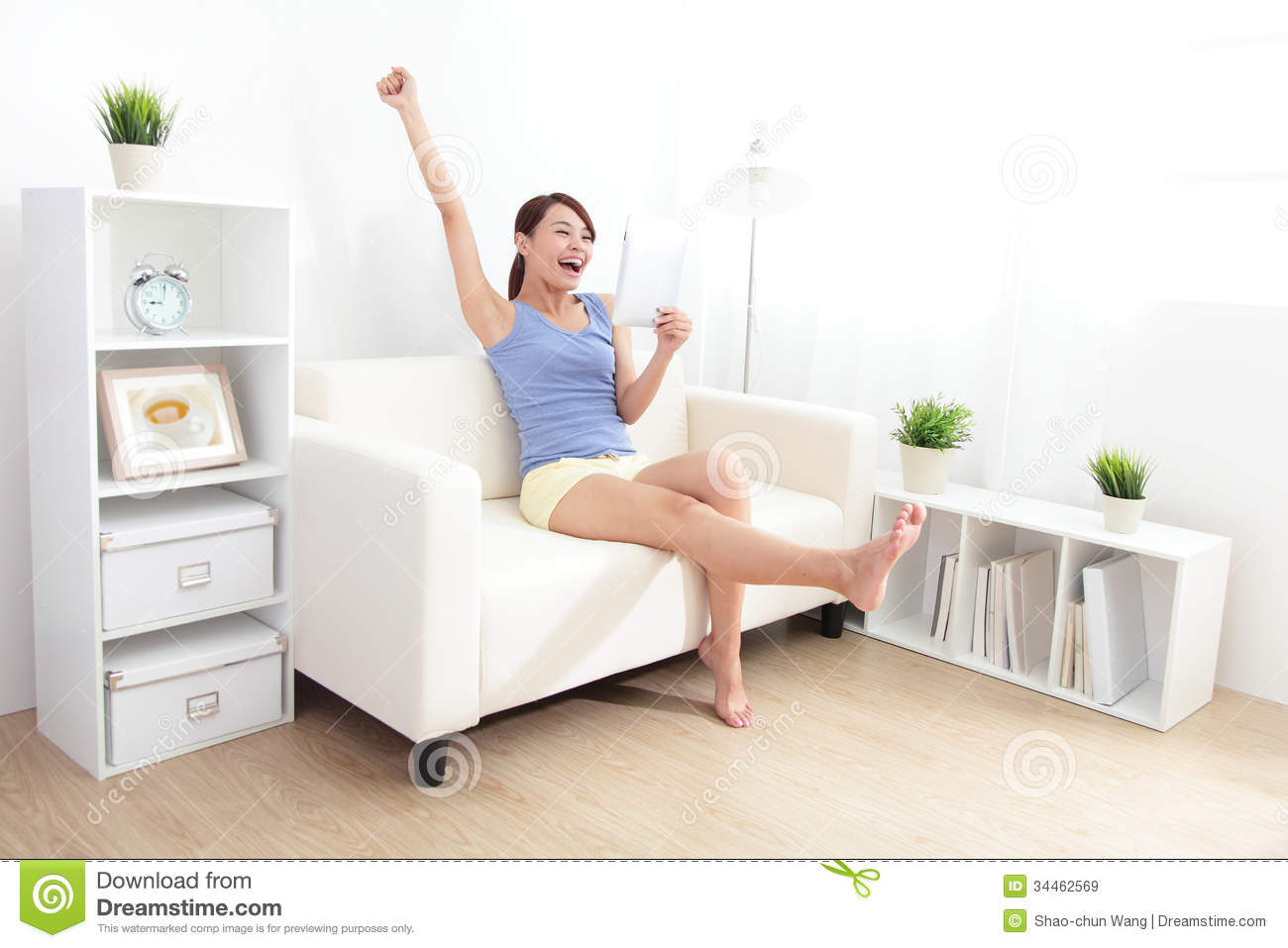 Happy Woman Using Tablet Pc On Sofa Royalty Free Stock