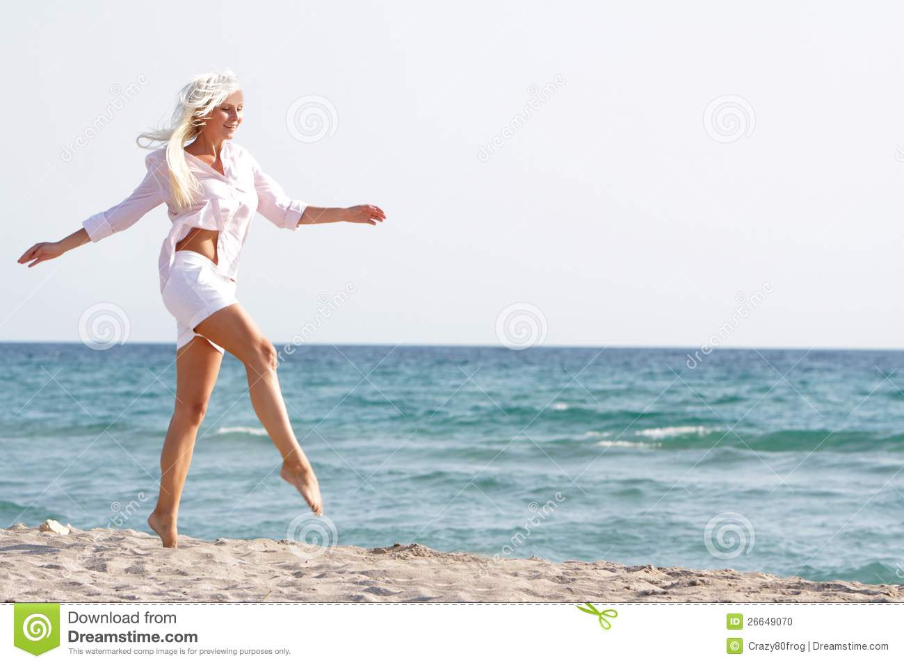 Woman walking on a beach royalty - Happy Woman Walking By Sand Beach Royalty Free Stock Photo