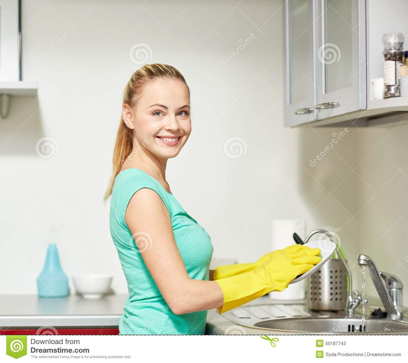 People Cleaning Kitchen