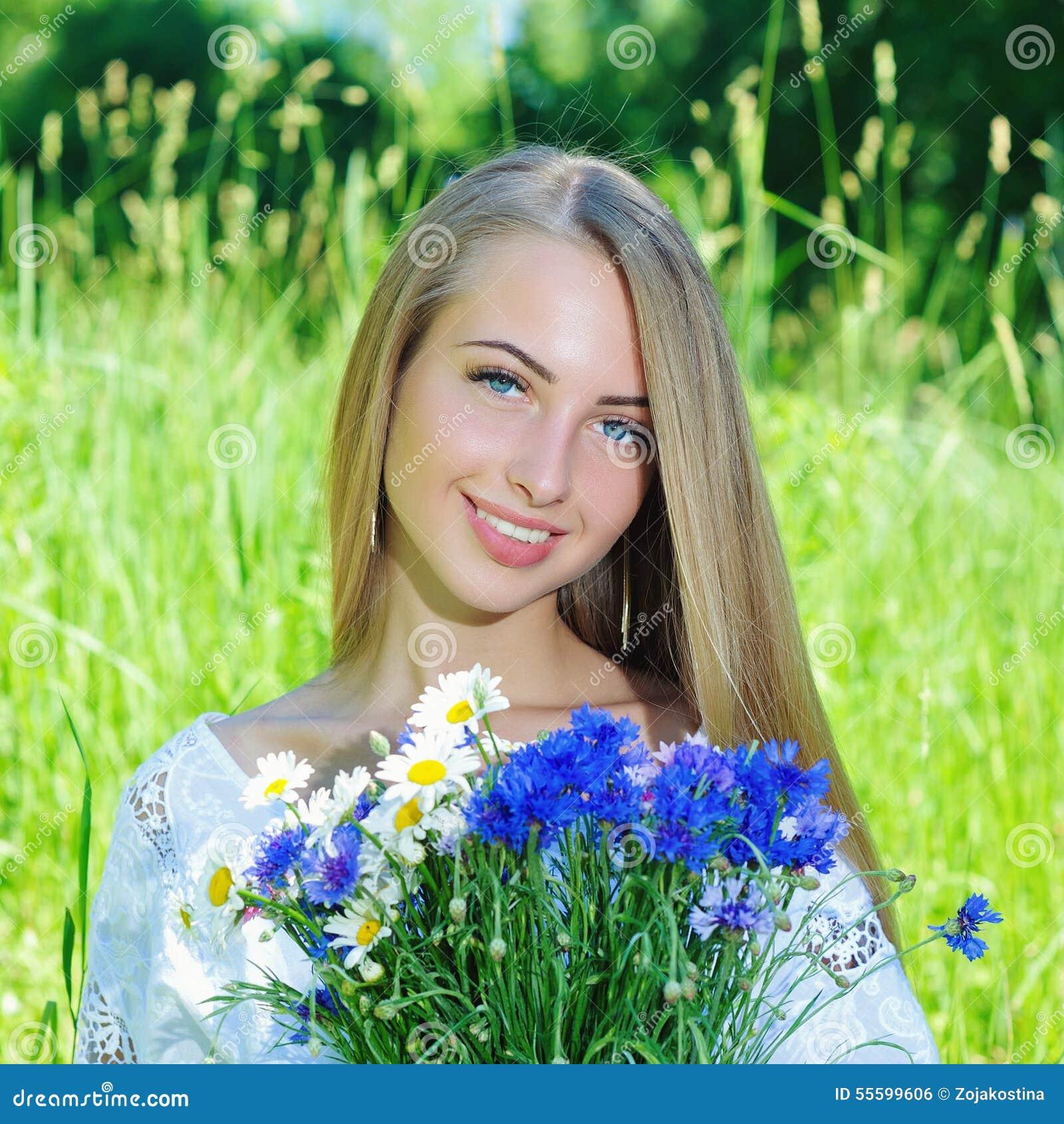 Happy Beautiful Woman Enjoying At Beach Stock Photo: Happy Woman Wit Bouquet Of Chamomiles And Cornflowers