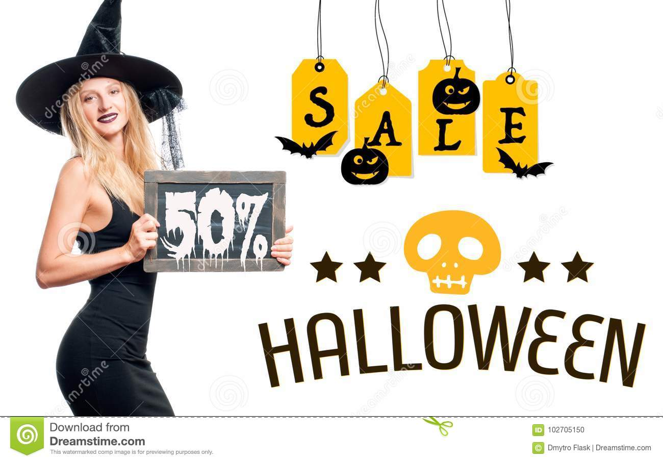 sale. happy woman in witch halloween costume with hat stock photo