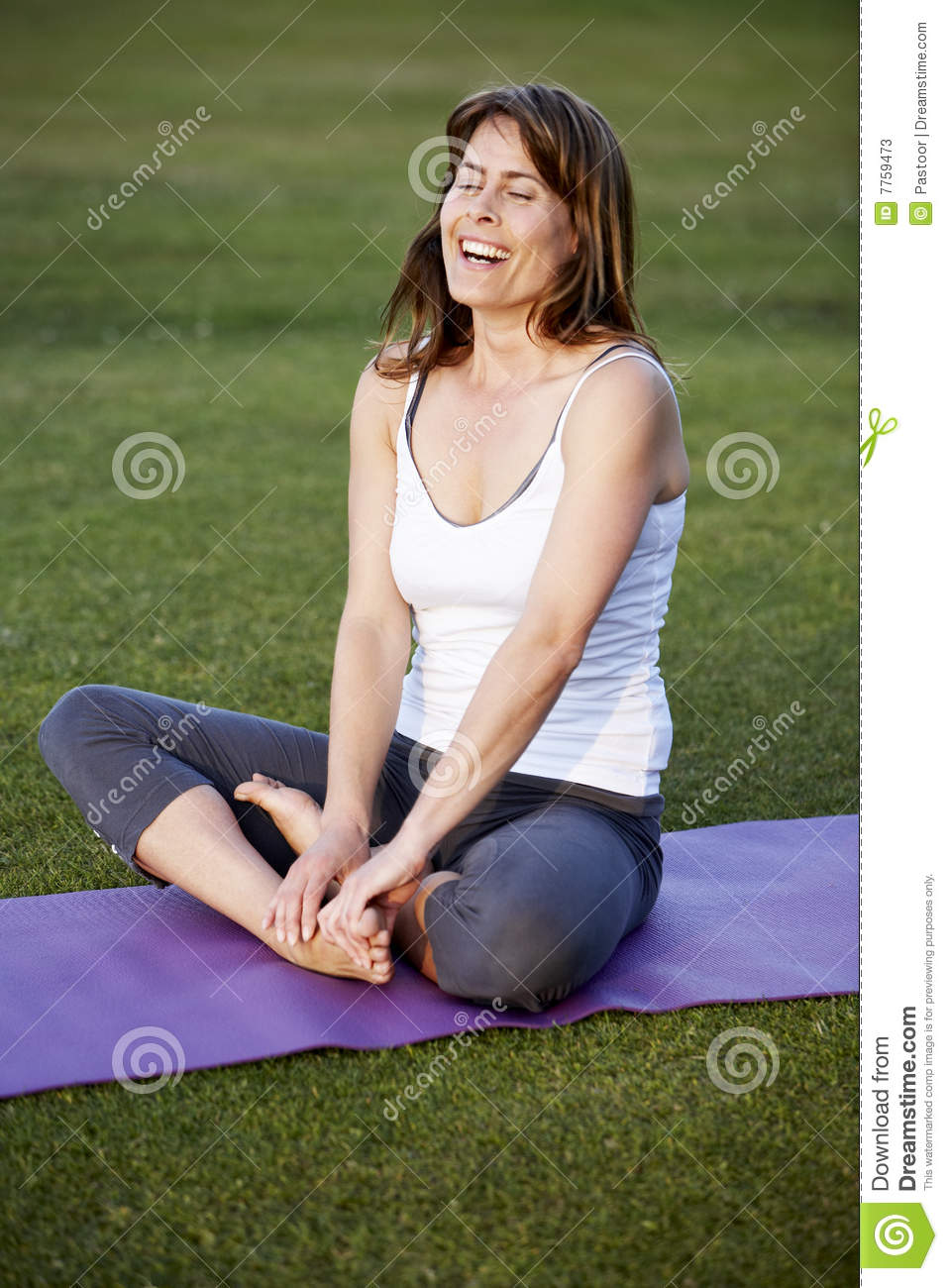 Happy woman in yoga position