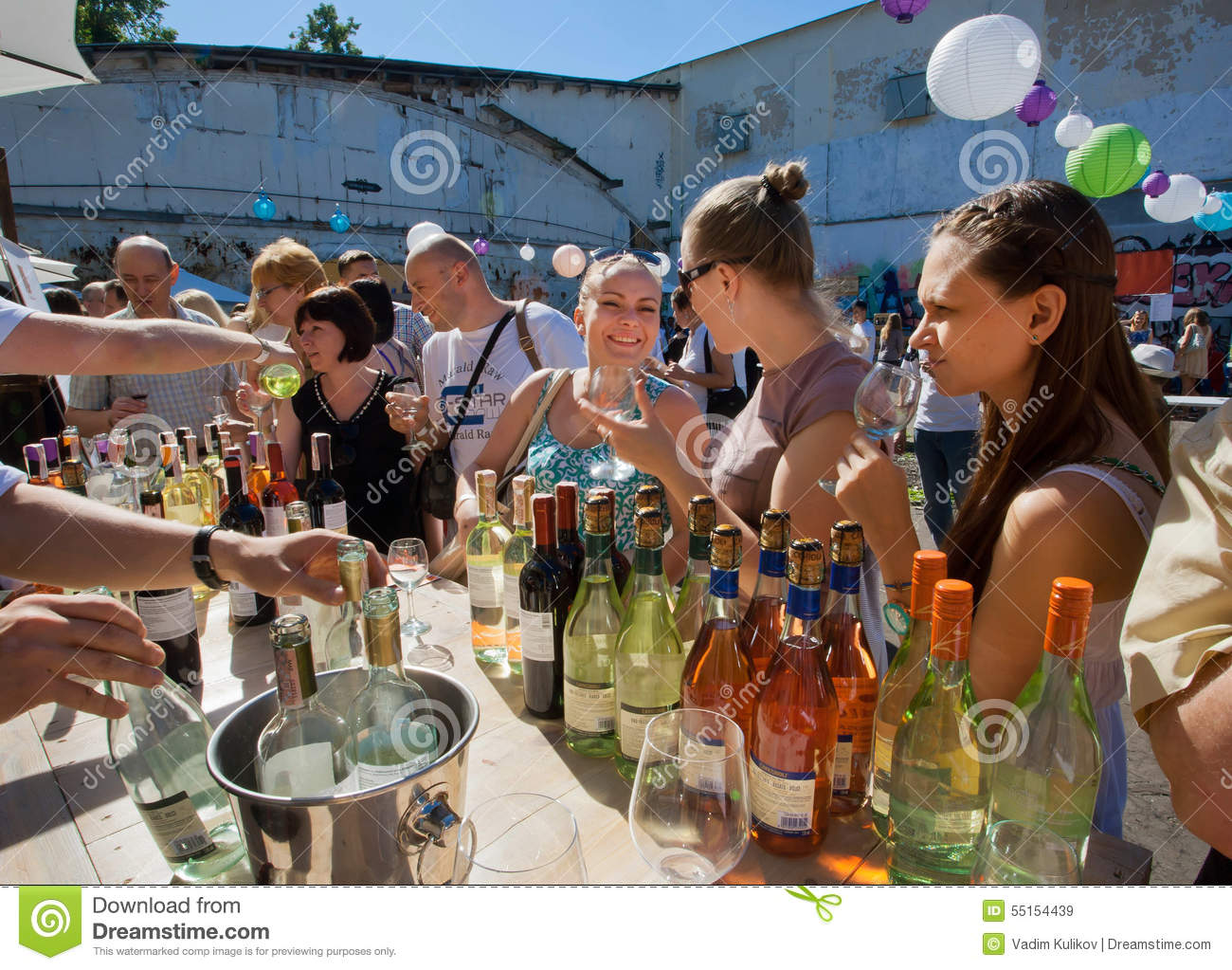 Happy women drinking wine in outdoor bar editorial stock for Food bar drinking game