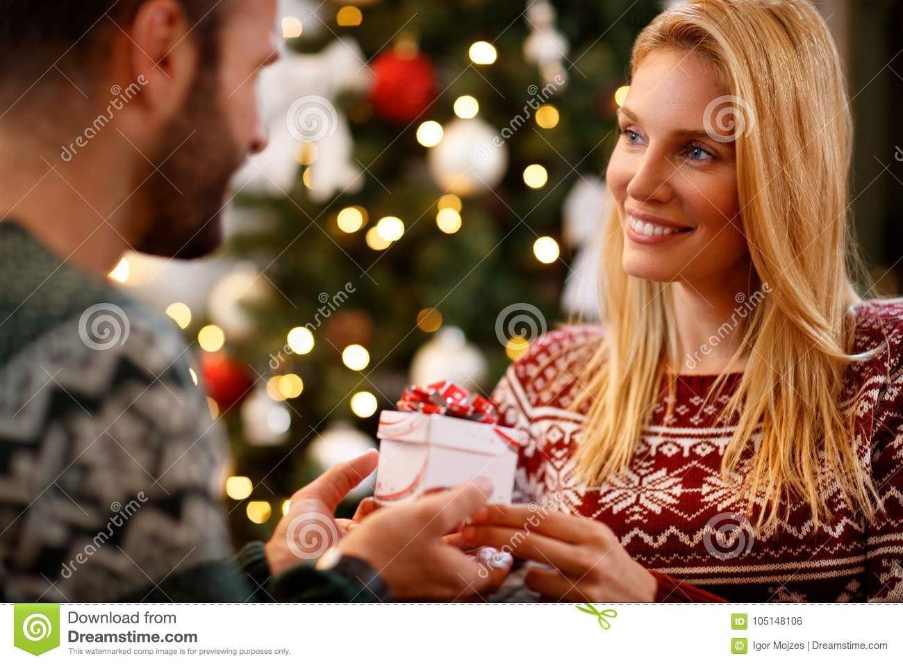 download woman giving christmas present to her husband stock photo image of lights enjoy - What To Buy My Husband For Christmas