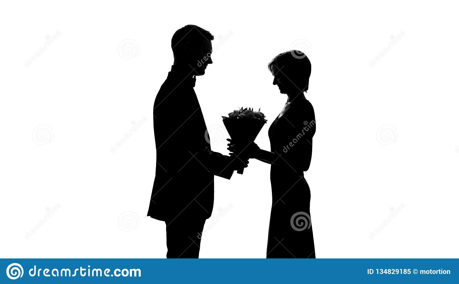 Happy woman receiving flower bouquet from man, romantic gift for anniversary
