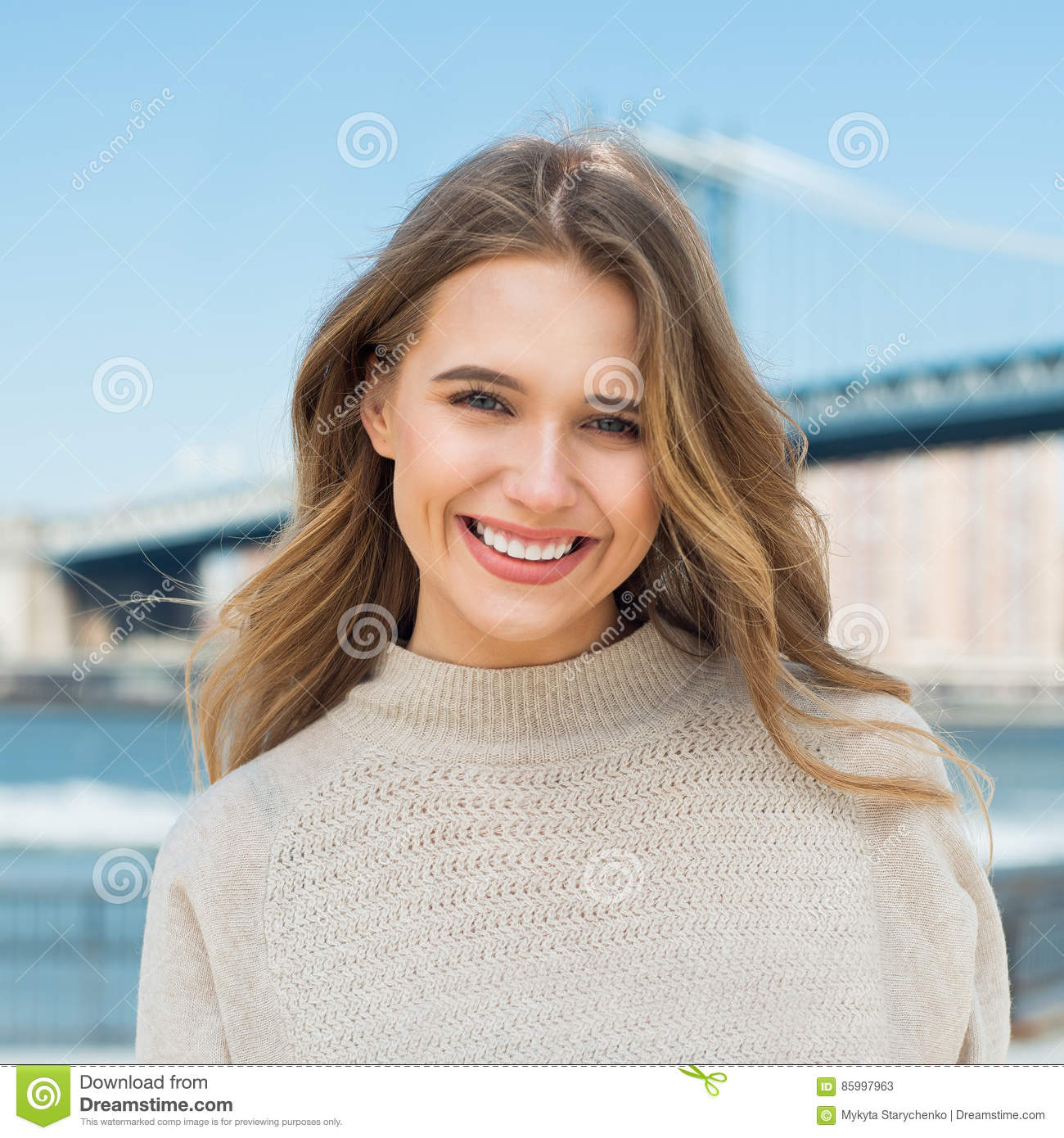 Happy young adult caucasian woman with white teeth smile in the city