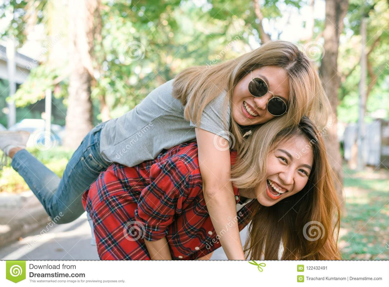 Happy Young Asian Women Couple Playing To Each Other While They Do