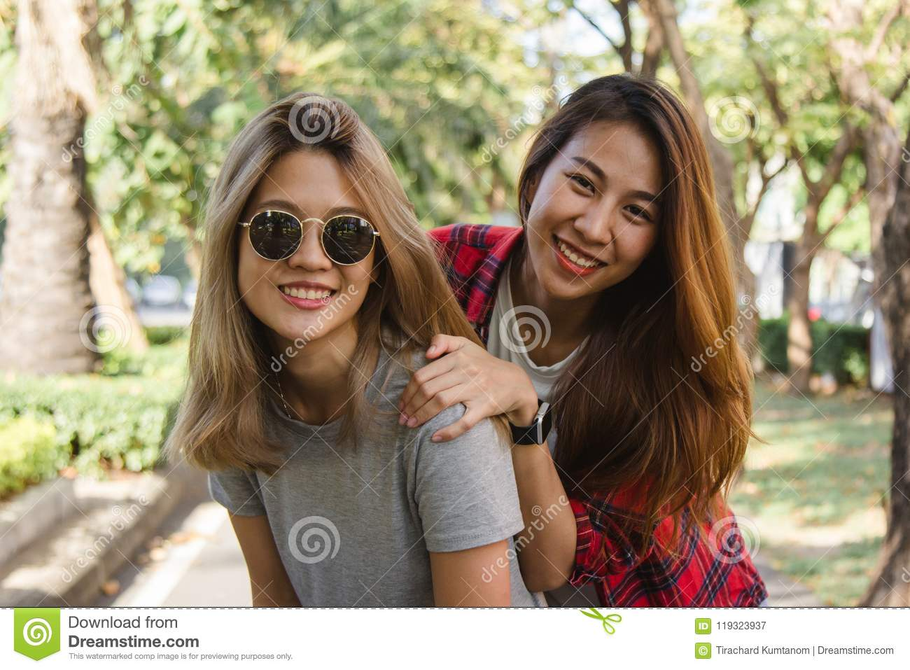 56de30700c3 Happy young asian women couple playing to each other while they do city  trip.
