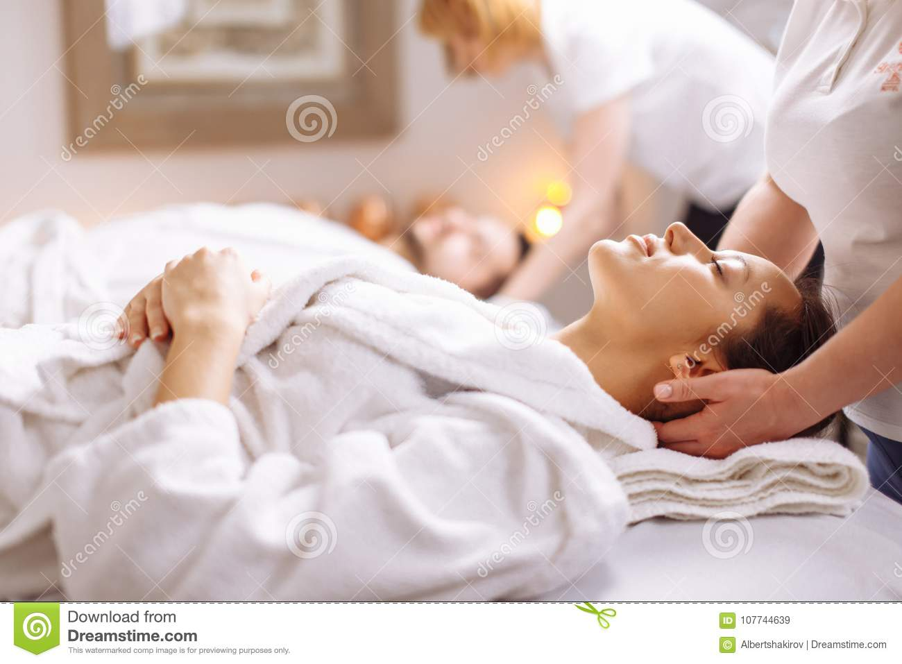 Young Couple Receiving Head Massage At Beauty Spa Stock Image