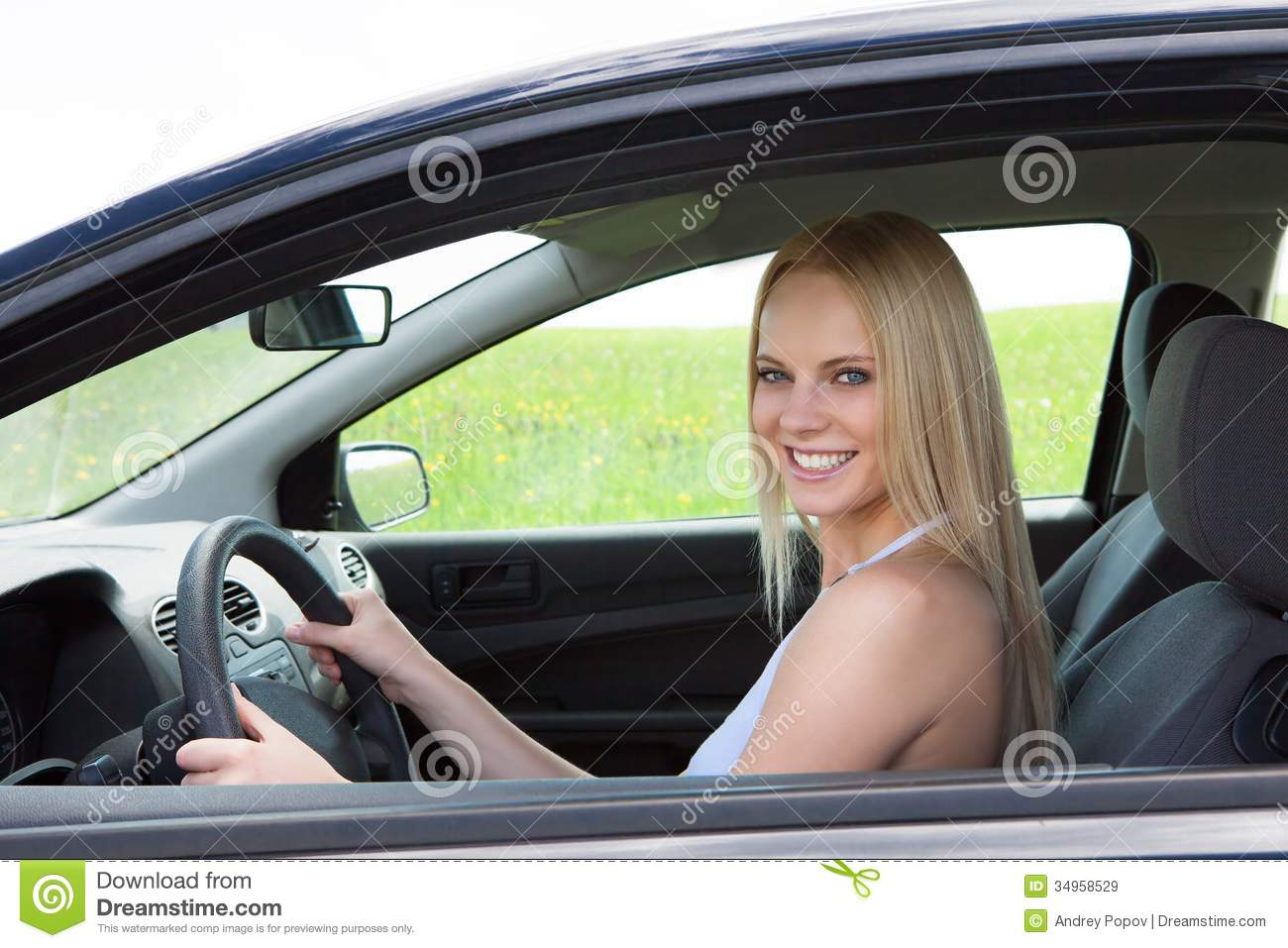happy-young-beautiful-woman-driving-car-blonde-34958529.jpg