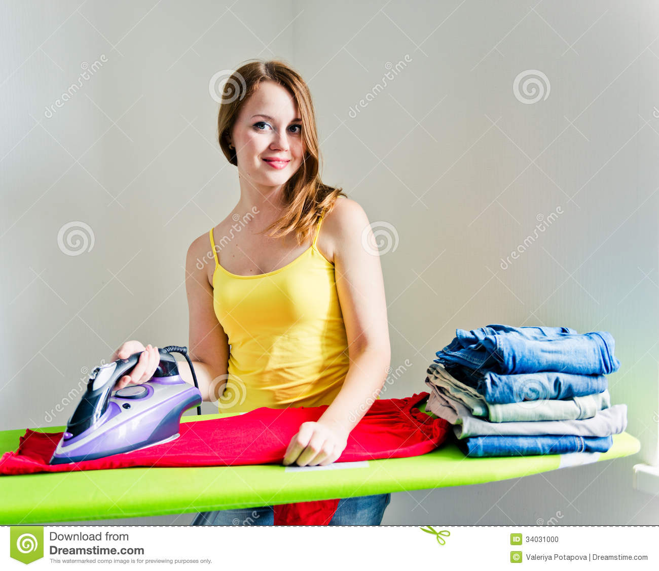 Happy Young Beautiful Woman Ironing Clothes. Stock Photo ...
