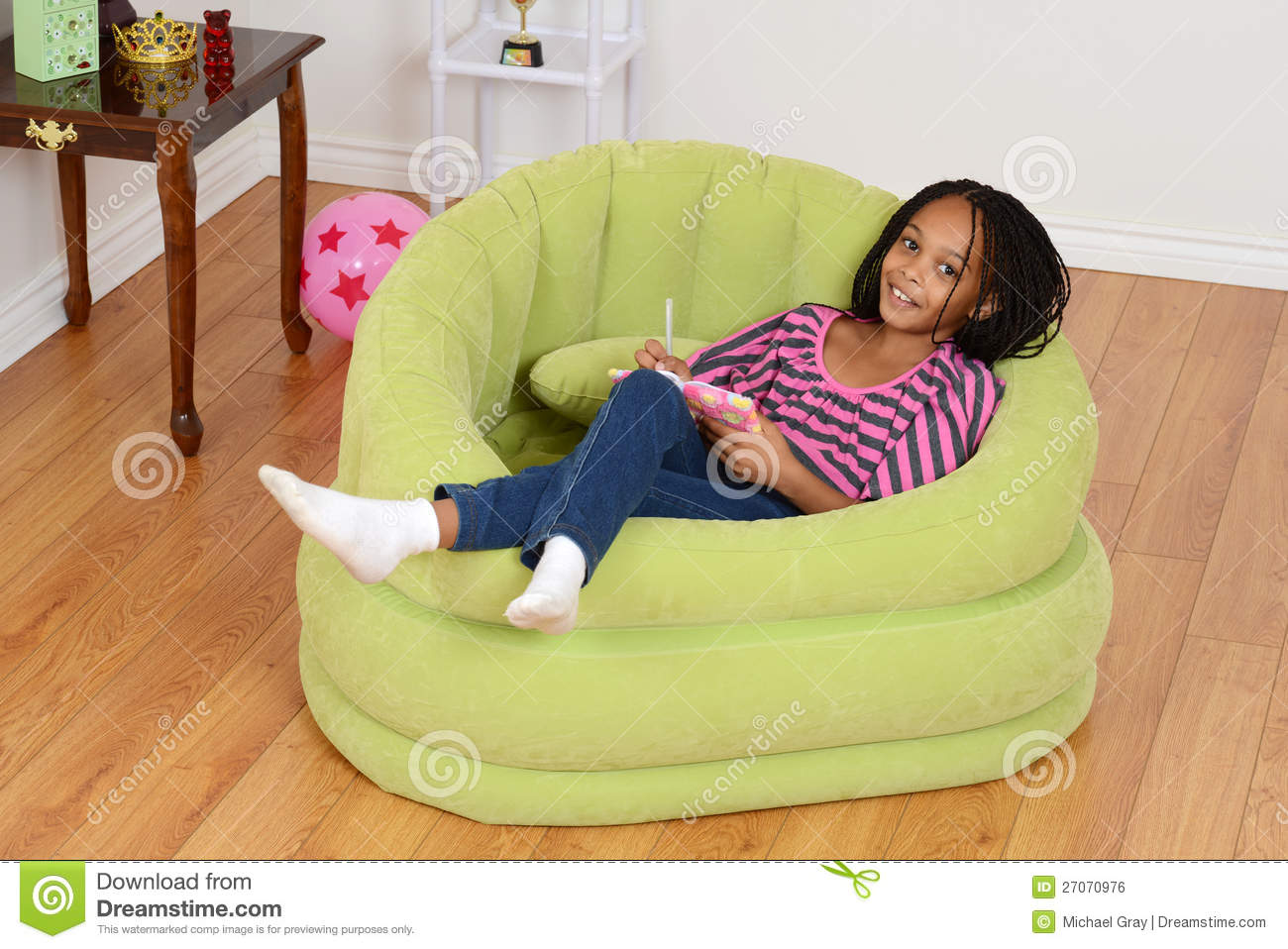 Black child sitting in chair - Royalty Free Stock Photo Download Happy Young Black Child