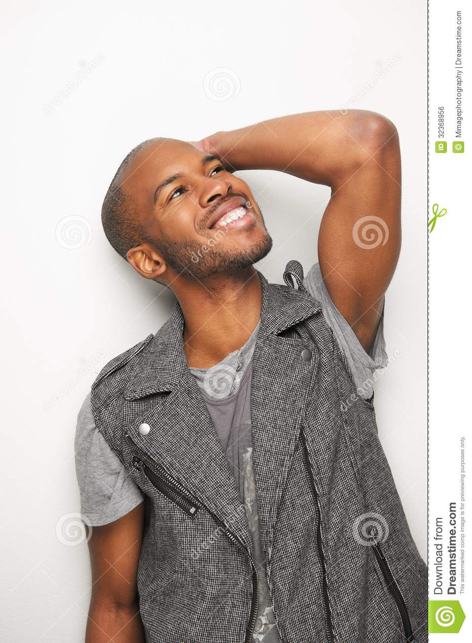 Happy Young Black Man With Hand To Head Stock Photo