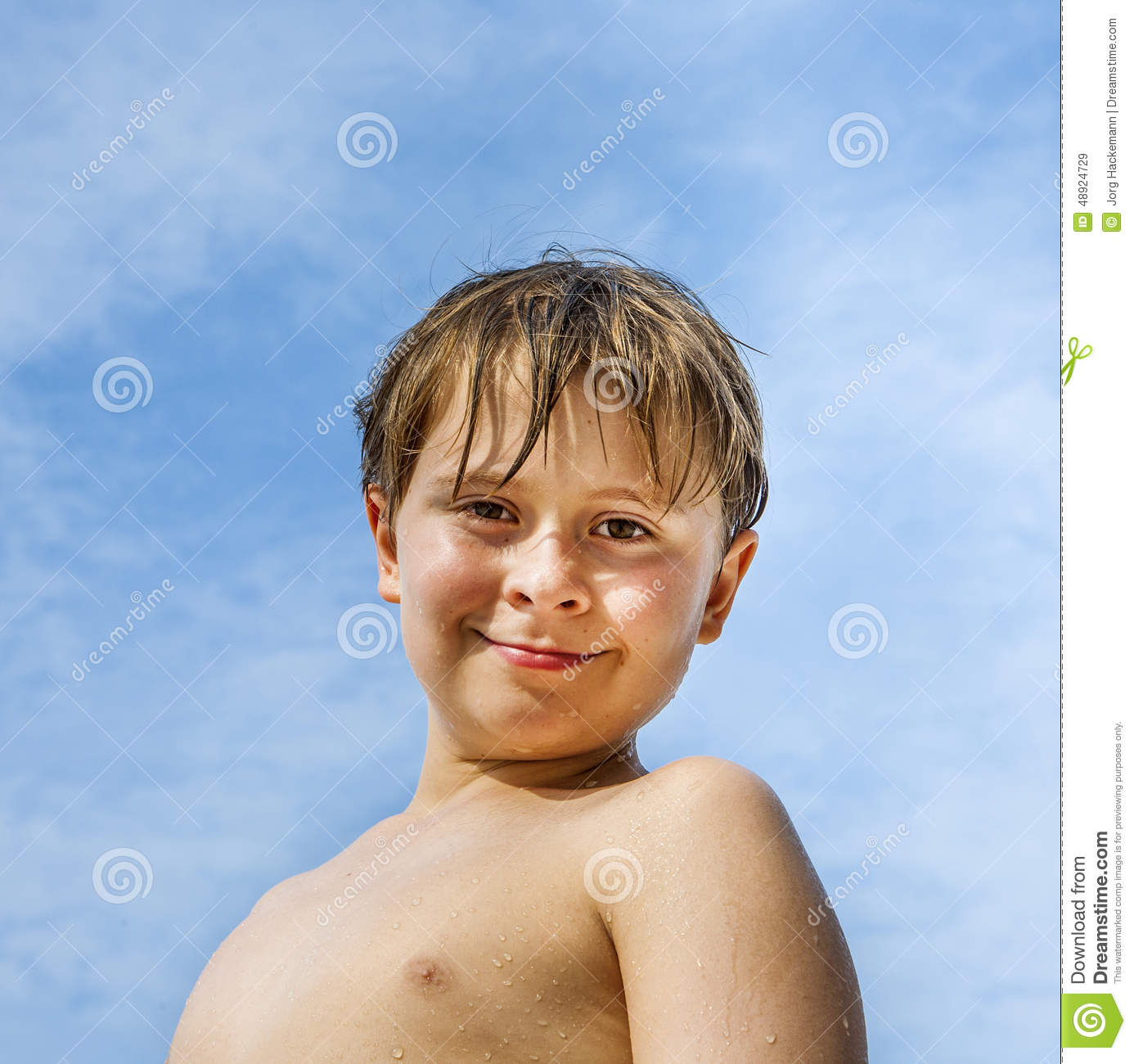 Happy Young Boy With Brown Hair And Eyes At The Beach