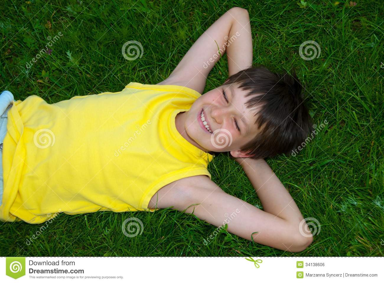 Happy young boy on grass