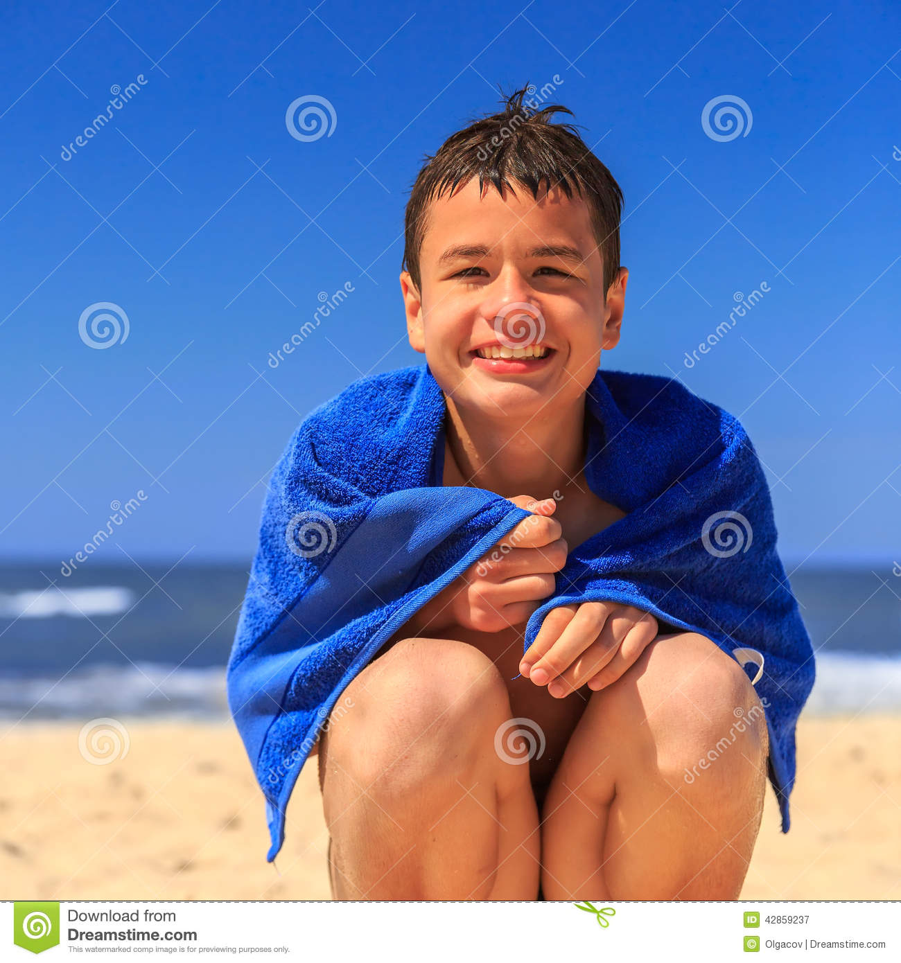 Face Towel Dream Meaning: Happy Young Boy On The Sea Beach Stock Image