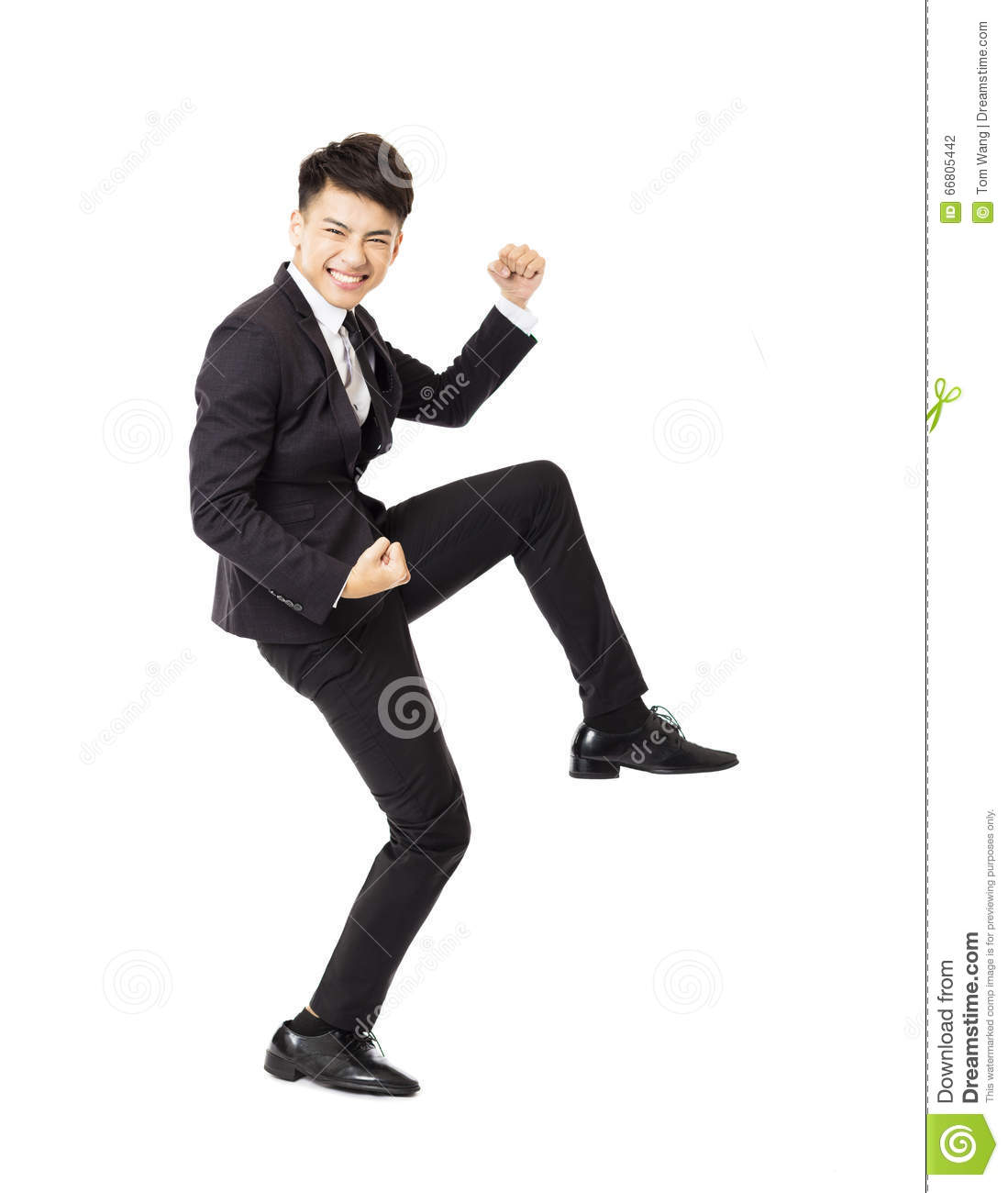 Happy young business man with successful gesture