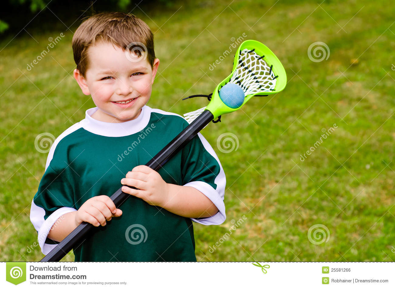 Happy young child lacrosse player