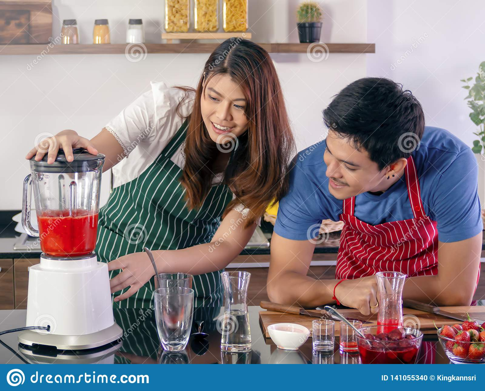 Happy young couple cooking together