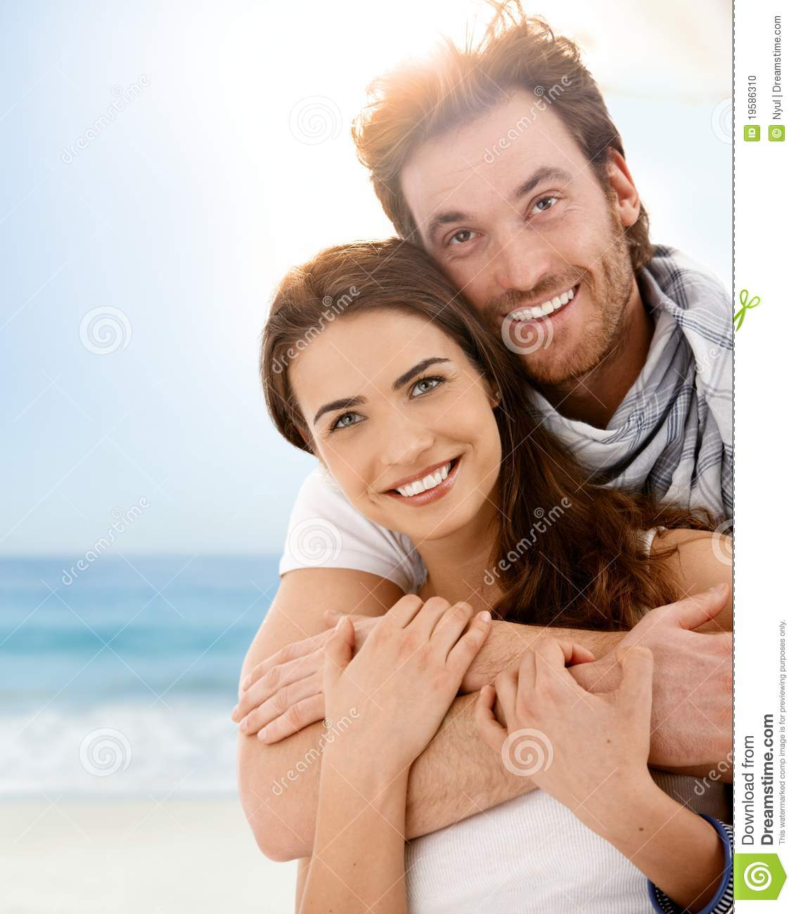 Happy Young Couple Embracing On Summer Beach Stock Photo
