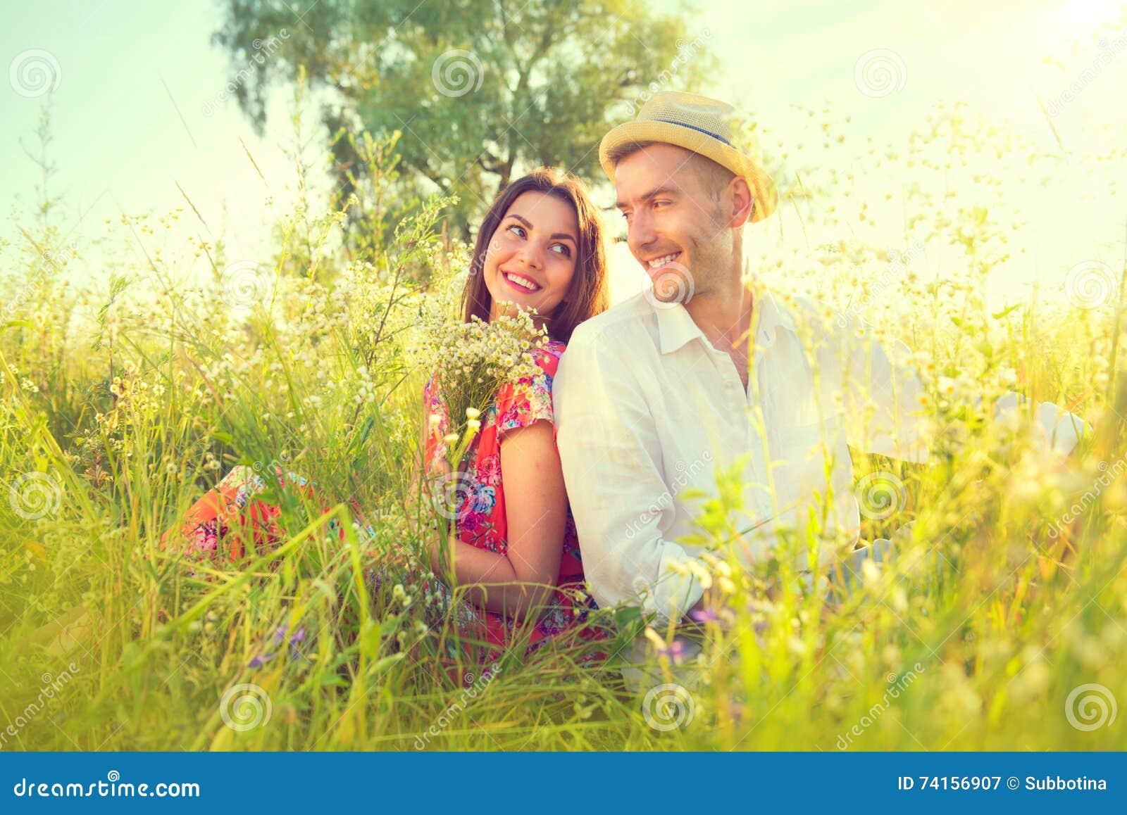 Happy young couple enjoying nature