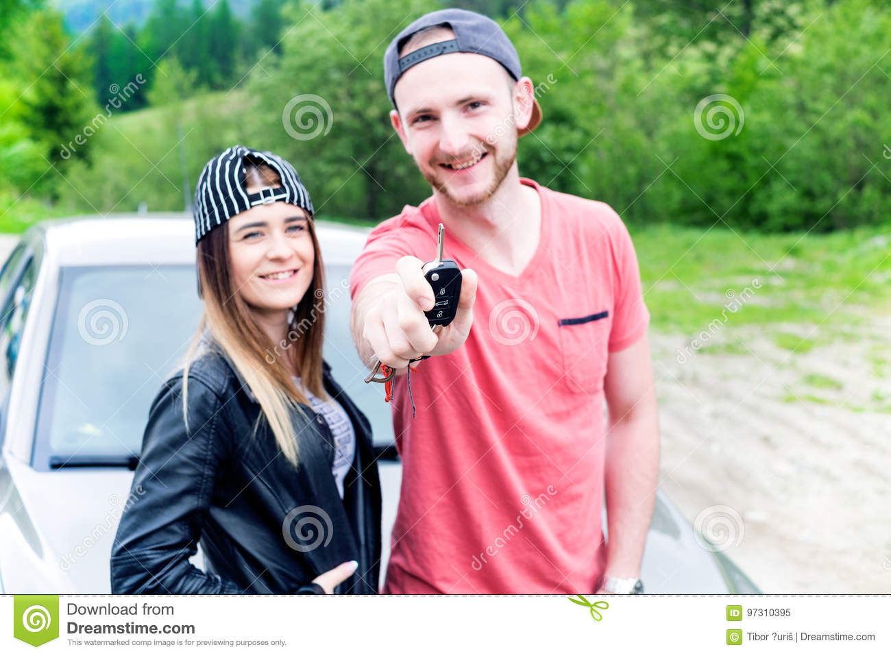 Happy young couple, friends making selfie while sitting in car. Summer time. Caucasian people. Concept of transportation.