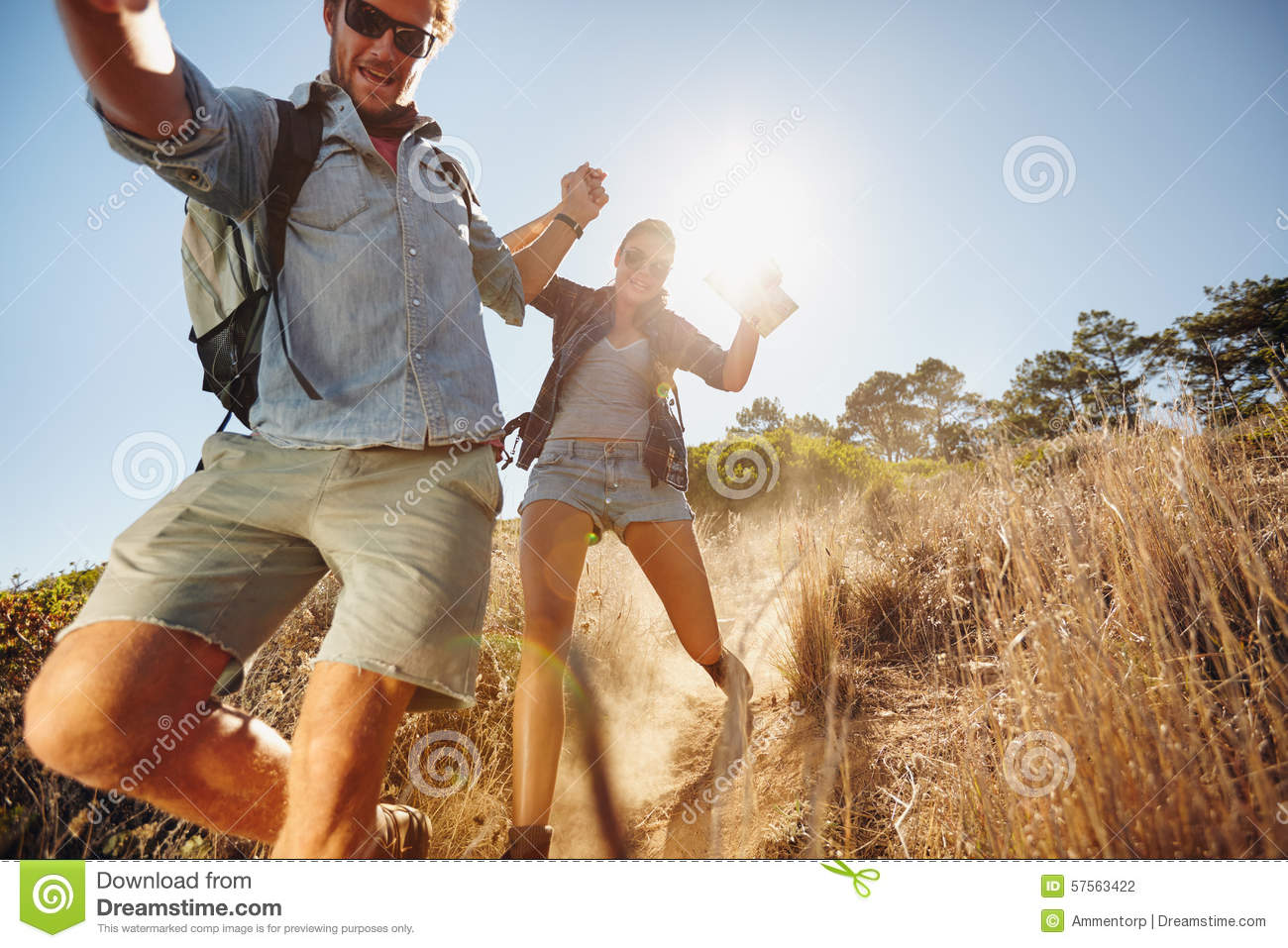 Happy young couple having fun on their hiking trip
