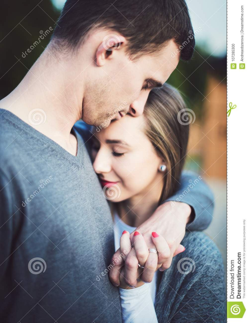 Happy Young Couple In Love On A Date Hugging Loving Couple Romance Stock Photo Image Of Hands Love 107285300