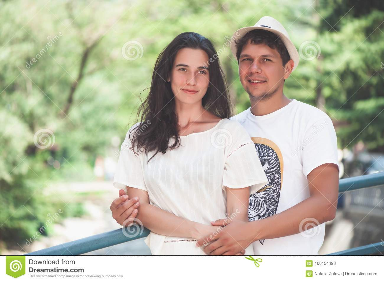 Happy young couple in love hugging enjoys spring day