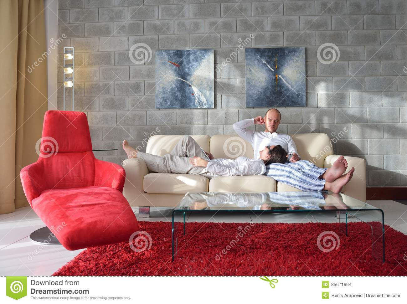 Happy young couple relax at home stock images image for Young modern living room