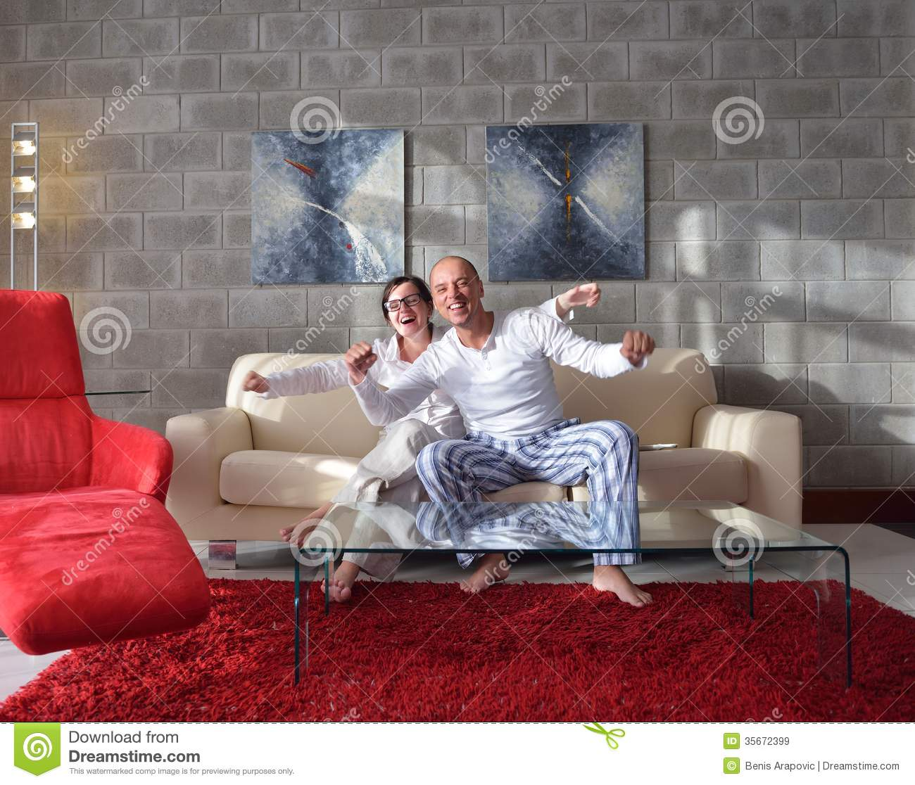 Happy young couple relax at home royalty free stock images for Living room ideas young couples
