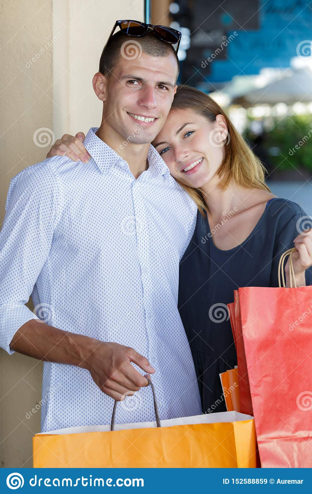 Happy young couple with shopping bags