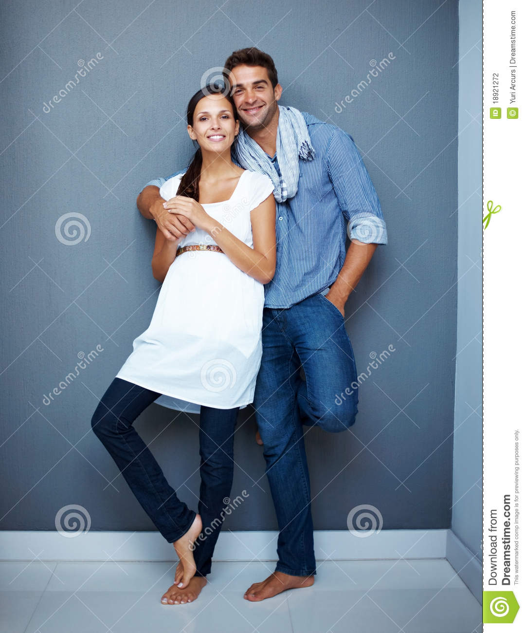 Happy Young Couple Standing Together Stock Photo