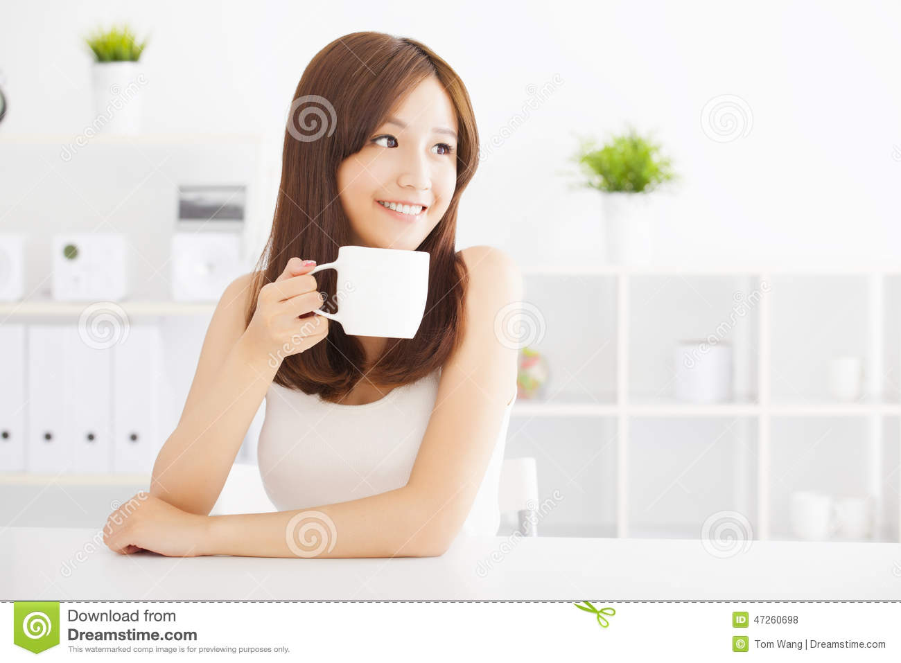 Happy young drinking coffee